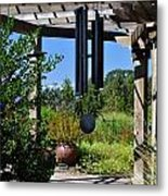 Wind Chime In A Garden Metal Print by Mandy Judson