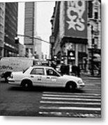yellow cab taxi blurs past pedestrian waiting at crosswalk on Broadway outside macys new york usa Metal Print by Joe Fox