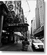 yellow taxi cab waits outside entrance to Macys department store on Broadway and 34th street Metal Print by Joe Fox