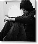 Young Dark Haired Teenage Man Sitting On The Floor Of The Bathroom With Back Against The Wall In The Metal Print by Joe Fox