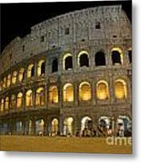 Coliseum Illuminated At Night. Rome Metal Print by Bernard Jaubert