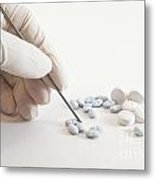 Gloved Hand And Medicinal Pills Metal Print by Blink Images