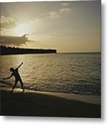 A Child, Silhouetted At Sunset, Throws Metal Print by Raul Touzon