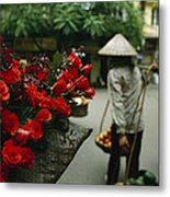 A Fruit Vendor In A Conical Hat Passes Metal Print by Justin Guariglia