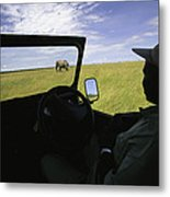 A Guide In A Jeep Observing An African Metal Print by Michael Melford