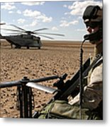 A Marine Assembles A Radio Antenna Metal Print by Stocktrek Images