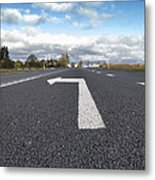 A Metalled Road With A Large Metal Print by Jaak Nilson