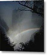 A Rainbow Arcs Across Victoria Falls Metal Print by James L. Stanfield