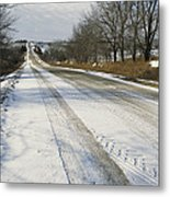 A Snow-covered Road Passes Metal Print by Joel Sartore