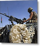 A Soldier Of The British Army Mans Metal Print by Andrew Chittock