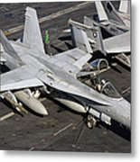 A Us Navy Fa-18c Hornet Parked Metal Print by Giovanni Colla