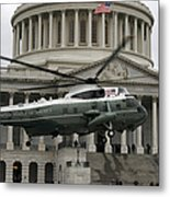 A Vh-60 Helicopter Lands In Front Metal Print by Stocktrek Images