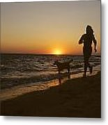 A Woman And Her Dog Running Metal Print by Skip Brown