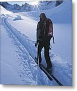 A Woman Skiing In The Selkirk Metal Print by Jimmy Chin