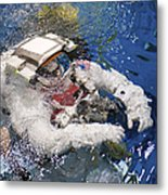 An Astronaut Is Submerged In The Water Metal Print by Stocktrek Images