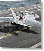 An Fa-18f Super Hornet Traps An Metal Print by Stocktrek Images