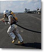 Aviation Boatswain's Mate Carries Metal Print by Stocktrek Images