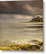 Bamburgh Castle Under A Cloudy Sky Metal Print by John Short