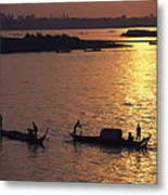 Boats Silhouetted On The Mekong River Metal Print by Steve Raymer