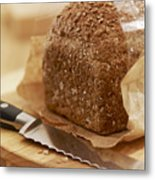 Close Up Of Knife And Loaf Of Bread In Wrapper Metal Print by Adam Gault