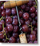 Corkscrew And Wine Cork On Red Grapes Metal Print by Garry Gay