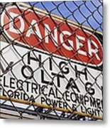 Danger High Voltage Sign In Cocoa Florida Metal Print by Mark Williamson