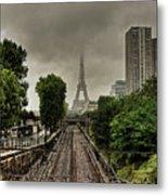 Eiffel Tower In Clouds Metal Print by Stéphanie Benjamin