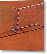 Football Net On Red Ground Metal Print by Daniel Kulinski