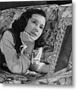 Girl (8-9) Lying On Couch, Holding Framed Photo , (b&w) Metal Print by George Marks