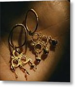 Gold Earrings Hung With Pearls Are Part Metal Print by Ira Block