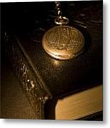 Gold Pocket Watch Resting On A Book Metal Print by Philippe Widling