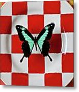 Green And Black Butterfly On Red Checker Plate Metal Print by Garry Gay