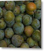 Green Plums Fill A Bin Outside A Local Metal Print by Heather Perry