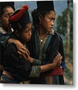 Hmong Girls Cling To Each Other Metal Print by W.E. Garrett