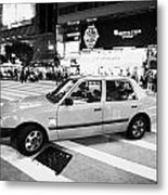 Hong Kong Red Taxi At Night On Nathan Road Downtown Kowloon Hong Kong Hksar China Metal Print by Joe Fox