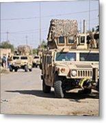 Humvees Conduct Security Metal Print by Stocktrek Images