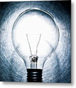 Light Bulb On Stainless Steel Background. Metal Print by Ballyscanlon