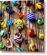 Marbles On Wooden Board Metal Print by Garry Gay