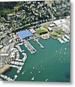 Marina And Coastal Community Metal Print by Eddy Joaquim