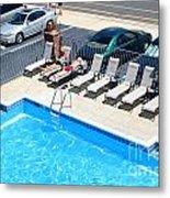 Motel Pool And Surroundings Metal Print by Susan Stevenson