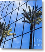 Palm Trees Reflection On Glass Office Building Metal Print by Paul Velgos