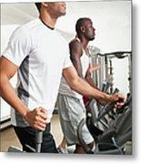 People Exercising In Health Club Metal Print by Erik Isakson
