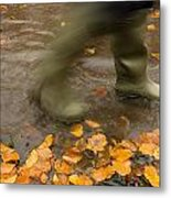 Person In Motion Walks Through Puddle Metal Print by John Short