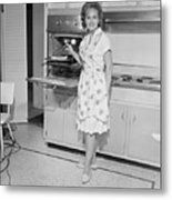 Portrait Of Woman Cooking In Kitchen Metal Print by George Marks