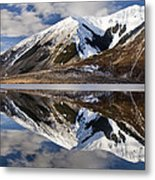 Reflection In Lake Pearson, Castle Hill Metal Print by Colin Monteath