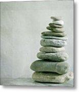 River Pebble Stone Pile Metal Print by Paul Grand Image