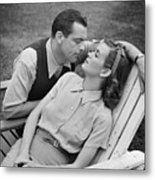 Romantic Couple Relaxing On Deckchair, (b&w) Metal Print by George Marks