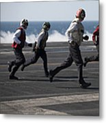 Sailors Clear The Landing Area Metal Print by Stocktrek Images