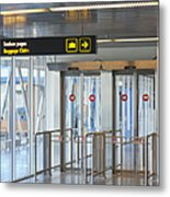 Sign Leading To Baggage Claim Metal Print by Jaak Nilson