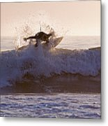 Surfer At Dusk Riding A Wave At Rincon Metal Print by Rich Reid